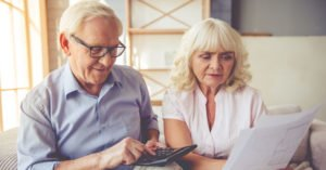 Senior couple looking at Social Security and Medicare papers
